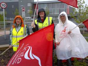 Strikers brave the rain in Wales